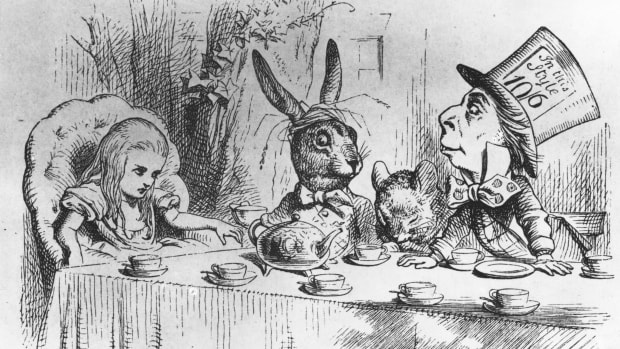 Alice, the March Hare, the dormouse and the mad hatter at the latter's tea party. From, 'Alice in Wonderland' by Lewis Carroll.