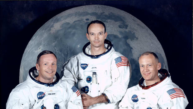 Neil Armstrong, Michael Collins and Edwin Aldrin Jr. in spacesuits at Manned Spacecraft Center