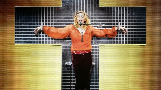 "Madonna performs at the first London concert of her ""Confessions"" world tour at Wembley Arena August 1, 2006 in London, England"
