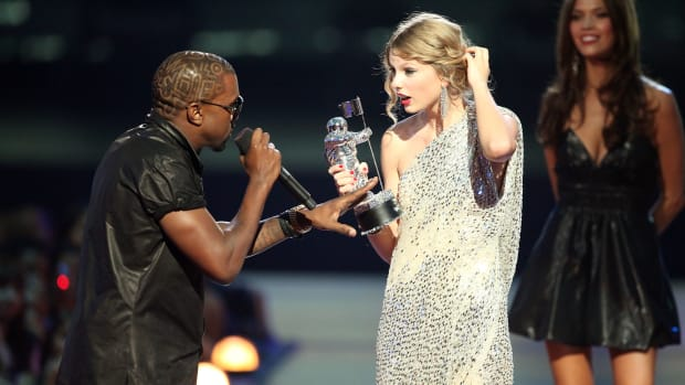Kanye West jumps onstage after Taylor Swift won the Best Female Video award during the 2009 MTV Video Music Awards on September 13, 2009, in New York City.