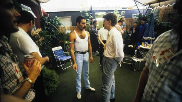 Freddie Mercury and David Bowie talking backstage at the Live Aid concert,