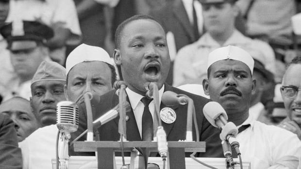 "Dr. Martin Luther King Jr. delivers his famous ""I Have a Dream"" speech in front of the Lincoln Memorial during the Freedom March on Washington in 1963"