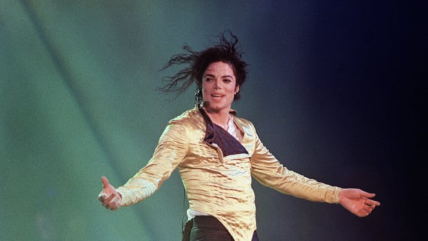 Michael Jackson preforms before an estimated audience of 60,000 in Brunei on July 16, 1996.