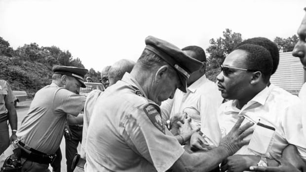 Martin Luther King being shoved back by Mississippi patrolmen during the 220 mile 'March Against Fear' from Memphis, Tennessee to Jackson, Mississippi