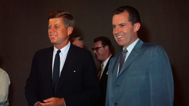John F. Kennedy and Richard M. Nixon smiling for the cameras prior to their appearing on the first nationally televised presidential debate