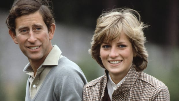 Prince Charles and Princess Diana pose by the River Dee while on their honeymoon