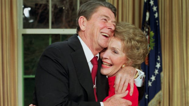 Ronald Reagan hugs his wife Nancy in the Oval Office