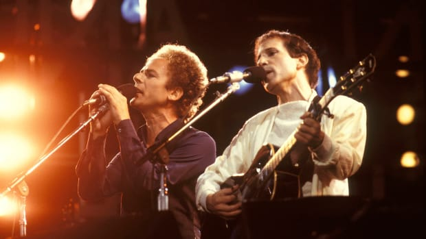 Paul Simon and Art Garfunkel perform live on stage at Wembley Stadium in London on June 19, 1982