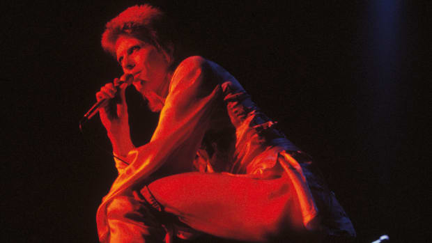David Bowie performing as Ziggy Stardust at the Hammersmith Odeon, 1973