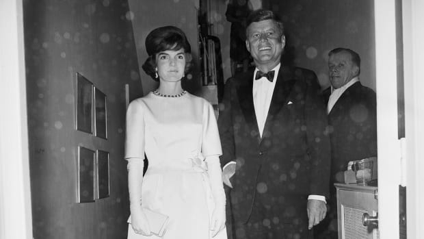 John F. Kennedy and Jacqueline Kennedy leave their Georgetown home to attend an Inaugural Concert at Constitution Hall and the gala at National Guard Armory