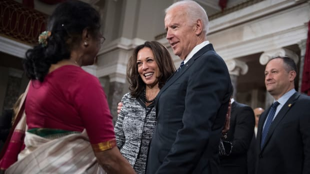 Joe Biden talks with Kamala Harris and her aunt, Dr. Sarala Gopalan, during a swearing-in ceremony in the Capitol's Old Senate Chamber, January 3, 2016.