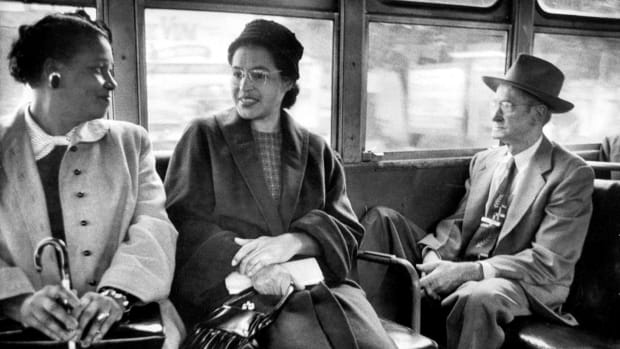Rosa Parks riding on a newly-integrated bus