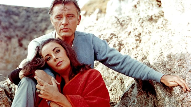 "Elizabeth Taylor and Richard Burton on the film set of ""The Sandpiper"" in 1965."