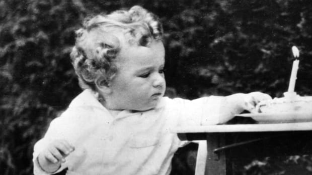 Charles Lindbergh Jr. sitting on a chair during his first birthday, 1931
