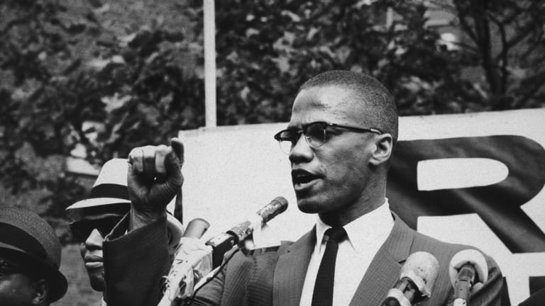 A biography of the early life black civil rights struggles and assassination of malcolm x