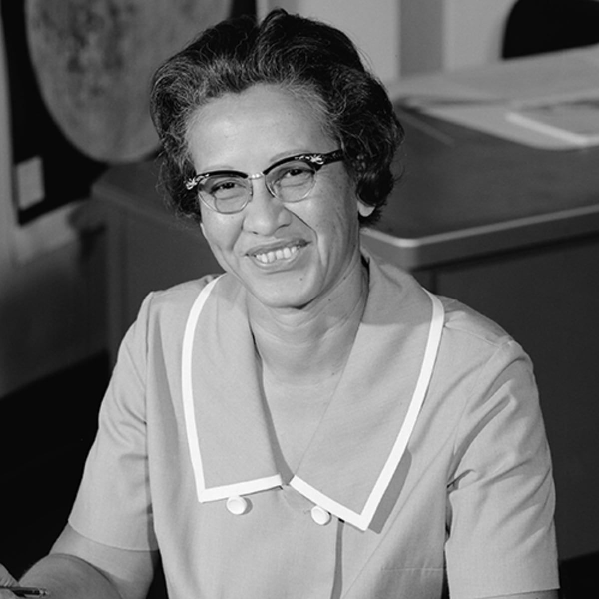 In this image, you can see the real Katherine Johnson at her desk at Langley Research Center in 1966.
