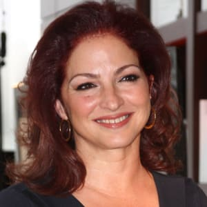 Gloria Estefan smiling at the camera