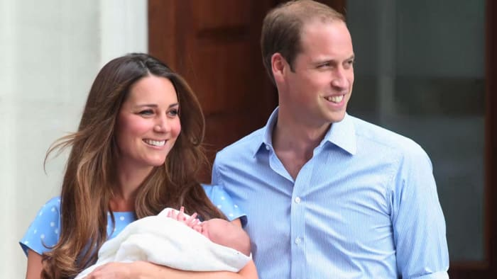 Prince William and Kate with their newborn son pose in front of London's St Mary's Hospital a day after his birth on July 23, 2013.
