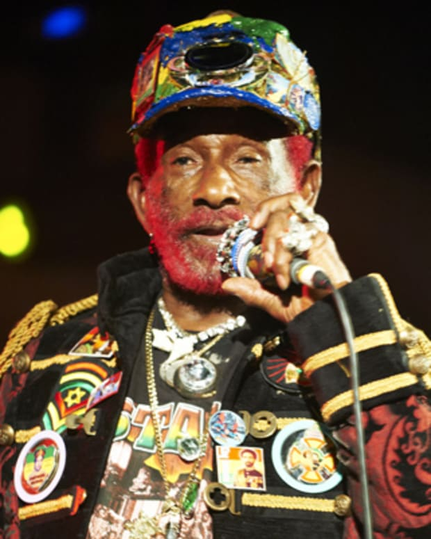 MINEHEAD, UNITED KINGDOM - MAY 13: Lee Scratch Perry performs on stage during the first day of ATP Festival curated by Animal Collective at Butlins Holiday Centre on May 13, 2011 in Minehead, United Kingdom. (Photo by Gary Wolstenholme/Redferns)