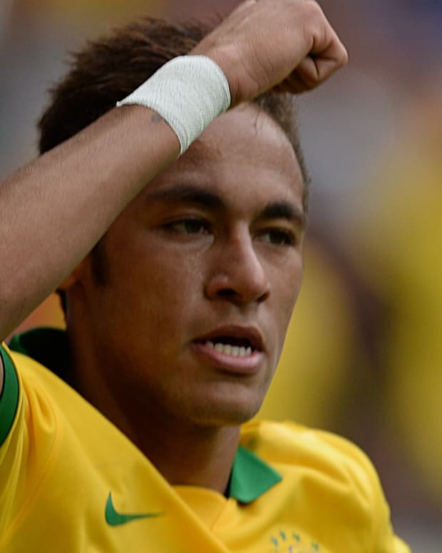 Brazil's Neymar celebrates his goal against Australia during their friendly football match at the Mane Garrincha National stadium, in Brasilia, Brazil, on September  7, 2013.  AFP PHOTO /VANDERLEI ALMEIDA        (Photo credit should read VANDERLEI ALMEIDA/AFP/Getty Images)