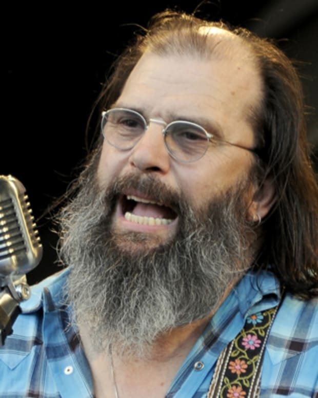 NEW ORLEANS, LA - MAY 6: Steve Earle performs with The Preservation Hall Jazz Band to celebrate their 50th Anniversary at the 2012 New Orleans Jazz & Heritage Festival at Fair Grounds Race Course on May 6, 2012 in New Orleans, Louisiana. (Photo by Tim Mosenfelder/Getty Images)
