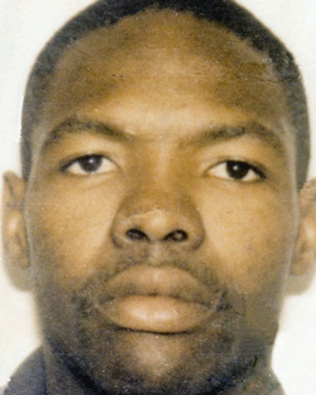 FILE - Undated handout file photo of Moses Sithole, a suspected serial killer alledgedly responsible for killing more than 30 people, who was shot and wounded when he attacked arresting policemen with an axe late Wednesday Oct. 18, 1995 near Johannesburg. The arrest ends a week-long hunt for the suspect in a series of deaths dating back more than a year around the cities of Pretoria and Johannesburg. Sithole, 31, is listed in satisfactory condition and under police guard in the hospital. (AP Photo/ Handout)