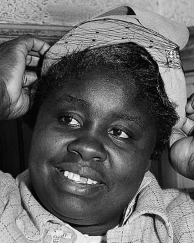 Georgia Gilmore adjusts her hat for the photographers after she testified as a defense witness in the racial bus boycott trial of Rev. Martin Luther King Jr., March 21, 1956 in Montgomery.  Mrs. Gilmore testified: 'When you pay your fare and they count the money, they don't know the Negro money from white money.' (AP Photo)