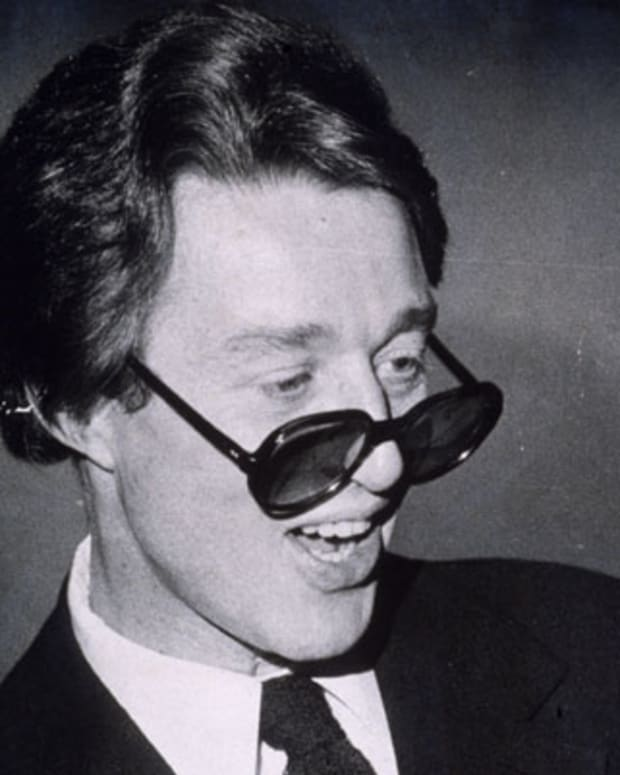 13th January 1975:  A candid portrait of American fashion designer Halston (Roy Halston Frowick, 1932 - 1990) wearing dark sunglasses pushed down to the tip of his nose, New York City. He designed hats and outfits for a number of famous personalities.  (Photo by Don Hogan Charles/New York Times Co./Getty Images)