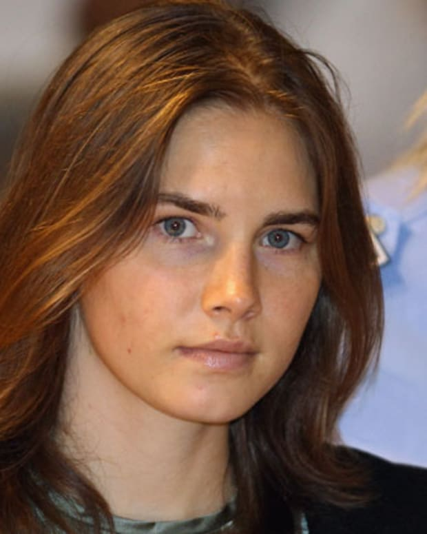 PERUGIA, ITALY - SEPTEMBER 29:  Amanda Knox is escorted to her appeal hearing at Perugia's Court of Appeal on September 29, 2011 in Perugia, Italy. Amanda Knox and Raffaele Sollecito are awaiting the verdict of their appeal that could see their conviction for the murder of Meredith Kercher overturned. American student Amanda Knox and her Italian ex-boyfriend Raffaele Sollecito, who were convicted in 2009 of killing their British roommate Meredith Kercher in Perugia, Italy in 2007, have served nearly four years in jail after being sentenced to 26 and 25 years respectively.  (Photo by Oli Scarff/Getty Images)