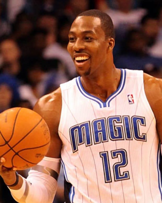 ORLANDO, FL - FEBRUARY 06:  Dwight Howard #12 of the Orlando Magic smiles during the game against the Los Angeles Clippers at Amway Center on February 6, 2012 in Orlando, Florida.   NOTE TO USER: User expressly acknowledges and agrees that, by downloading and or using this Photograph, user is consenting to the terms and conditions of the Getty Images License Agreement.  (Photo by Sam Greenwood/Getty Images)