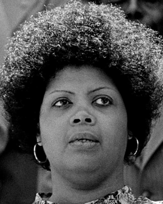 Linda Brown Smith, left, of Topeka, Kansas, listens to Benjamin L. Hooks, executive director of the NAACP, during ceremonies observing the 25th anniversay of the U.S. Supreme Court's desegregation ruling in the Brown v. Board of Education of Topeka in Columbus, S.C., May 1979.   It was Brown's father who initiated the class-action suit in  the Brown v. Board of Education of Topeka, Kans., which led to the U.S. Supreme Court's 1954 landmark decision against school segregation.  (AP Photo)