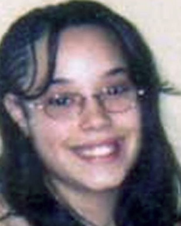 CLEVELAND, OH - MAY 7:  In this handout provided by the Federal Bureau of Investigation (FBI), Georgina DeJesus poses for an undated photo.  DeJesus was one of three women who believed to have been held captive for almost a decade in a home in Cleveland, Ohio. Amanda Berry, who went missing in 2003, Gina DeJesus, who went missing in 2004, and Michelle Knight, who went missing in 2002, managed to escape their captors on May 6, 2013. Three suspects, all brothers, were taken into custody.  (Photo by FBI via Getty Images)