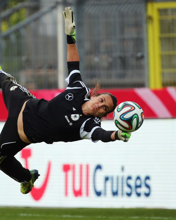 Nadine Angerer makes a save during a Germany training session at Carl-Benz-Stadion on April 9, 2014 in Mannheim, Germany