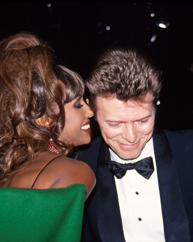 Iman and David Bowie sharing an intimate moment at a black-tie affair