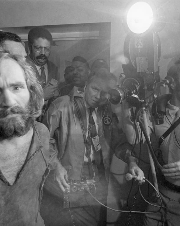 Charles Manson is brought into the Los Angeles city jail