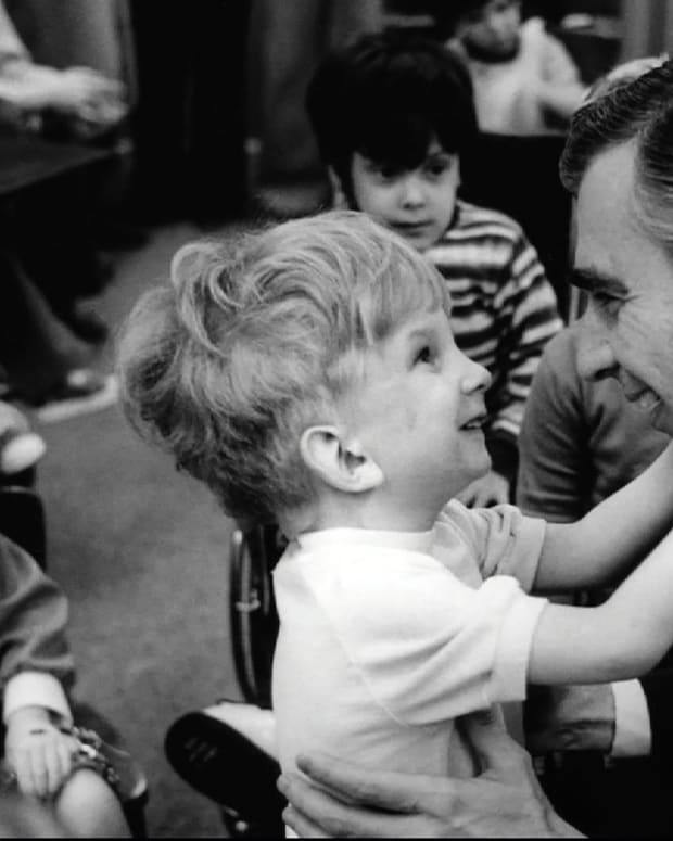 Mister Rogers with a young fan