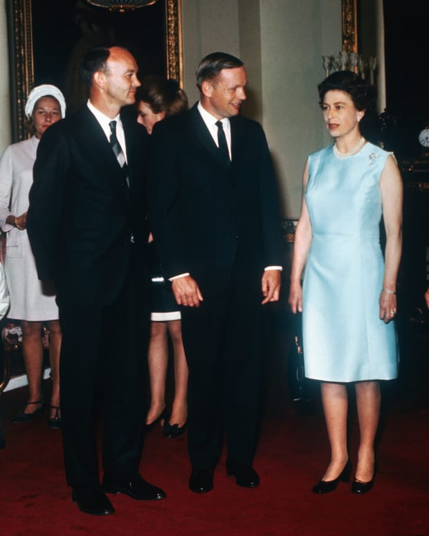 Queen Elizabeth II, Michael Collins, Neil Armstrong and Buzz Aldrin at Buckingham Palace as part of their world tour