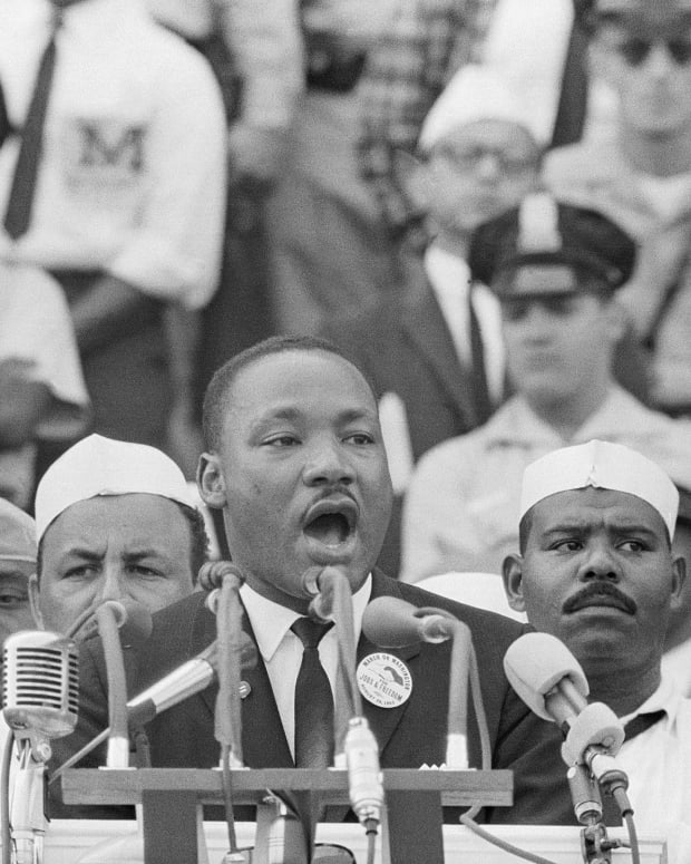 "Dr. Martin Luther King Jr. delivers his famous ""I Have a Dream"" speech in front of the Lincoln Memorial during the Freedom March on Washington in 1963."