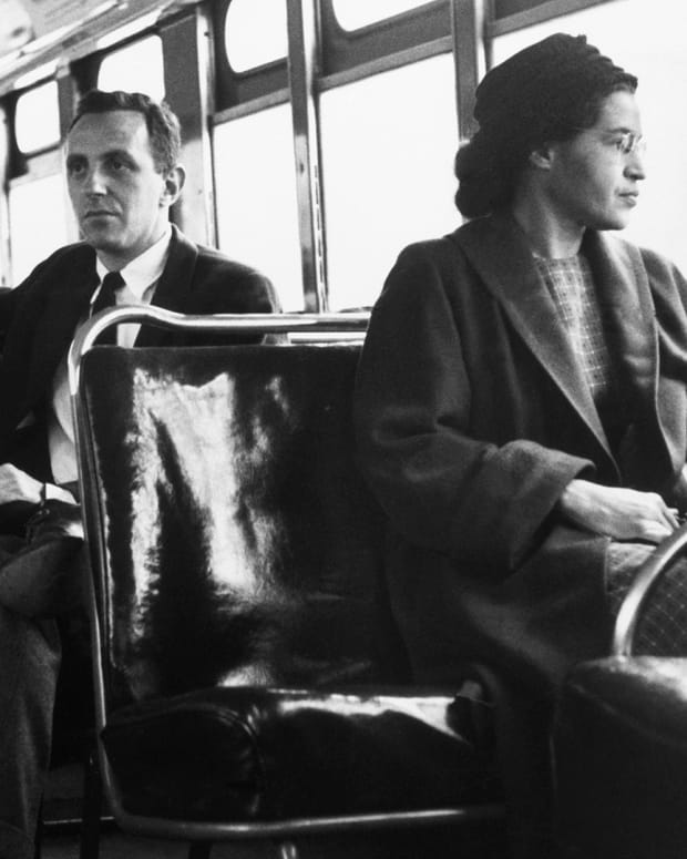 Rosa Parks sits in the front of a bus in Montgomery, Alabama, after the Supreme Court ruled segregation illegal on the city bus system on December 21, 1956