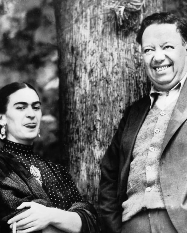 "While taking a break during the ""fake trial"" of Russian revolutionary Leon Trotsky, Kahlo and Rivera share a lighthearted pause."