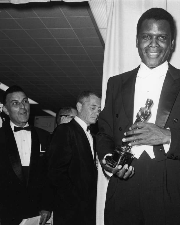 Sidney Poitier holds his Best Actor Oscar for director Ralph Nelson's film 'Lilies of The Field' backstage at the Academy Awards ceremony in Santa Monica, California