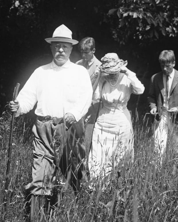 President Theodore Roosevelt hikes with his wife, Edith, and two sons, Teddy Jr. and Kermit, along their Sagamore Hill estate following a boat ride