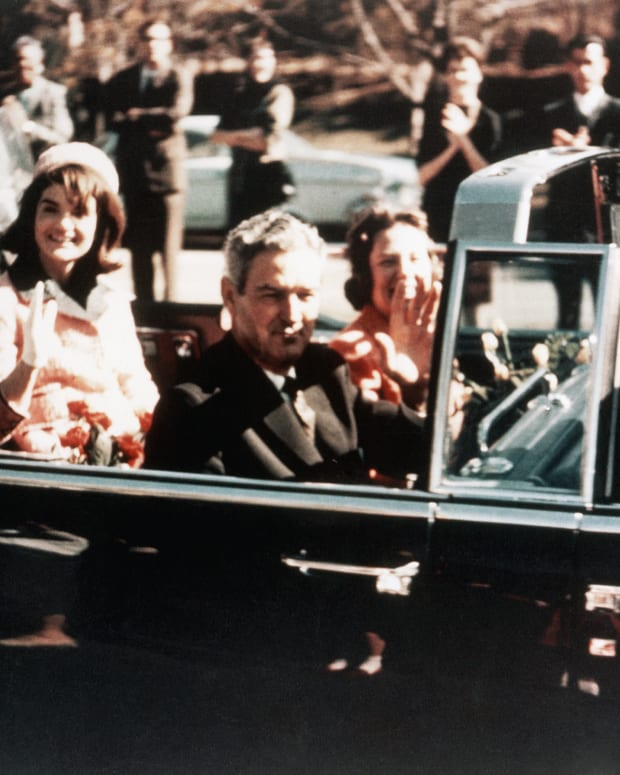 First Lady Jacqueline Kennedy, and Texas Governor John Connally ride through the streets of Dallas, Texas on November 22, 1963