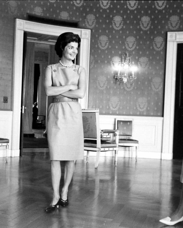 Jackie Kennedy in the process of redecorating the Blue Room in the White House