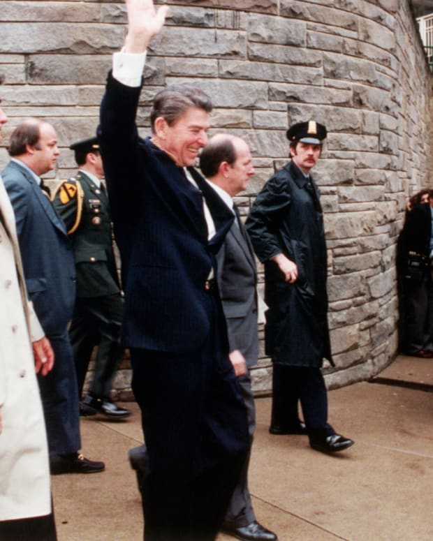 President Ronald Reagan waves as he leaves the Washington, D.C. Hilton just before being shot by John Hinckley Jr. in an assassination attempt on March 30, 1981