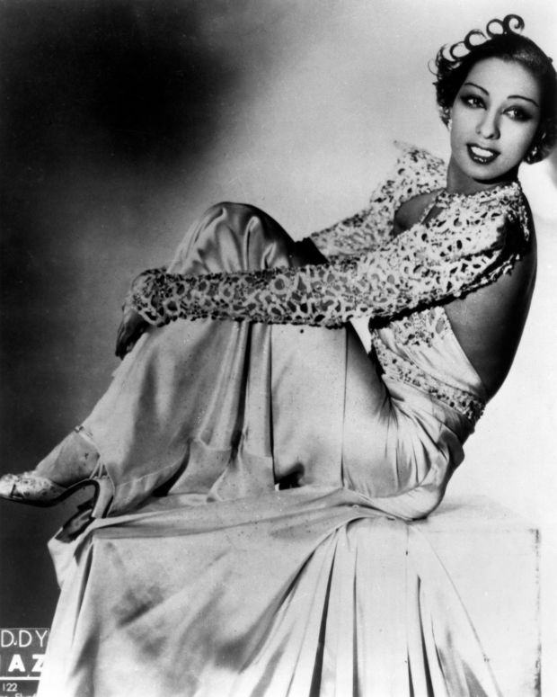 African-American Expats : A talented dancer and entertainer, Josephine Baker became the first   African-American female to star in a motion picture. She gained   international success in France during the 1920s with her performances   at the Folies Bergère music hall. She became a French citizen in 1937,   and her assistance in the French Resistance during World War II earned   her the Croix de Guerre French military award - the first American-born   woman to ever receive the honor. (Photo: Redferns)