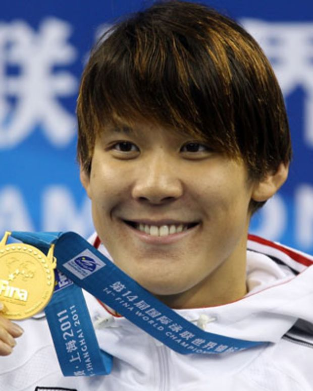 SHANGHAI, CHINA - JULY 24:  Tae Hwan Park of Korea poses with his gold medal after the Men's 400m Freestyle Final during Day Nine of the 14th FINA World Championships at the Oriental Sports Center on July 24, 2011 in Shanghai, China.  (Photo by Clive Rose/Getty Images)
