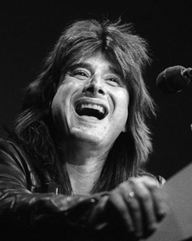 SAN FRANCISCO, CA-MARCH 21: Steve Perry at the podium as Journey receives the Outstanding Group award at the Bay Area Music Awards (BAMMIES) at the Civic Auditorium in San Francisco on March 21, 1987. (Photo by Clayton Call/Redferns)