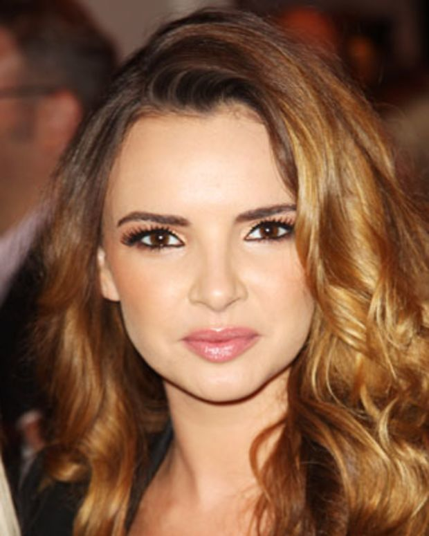 LONDON, ENGLAND - OCTOBER 25:  (UK TABLOID NEWSPAPERS OUT) Nadine Coyle arrives at the Q Awards 2010  held at The Grosvenor House Hotel on October 25, 2010 in London, England.  (Photo by Dave Hogan/Getty Images) *** Local Caption *** Nadine Coyle