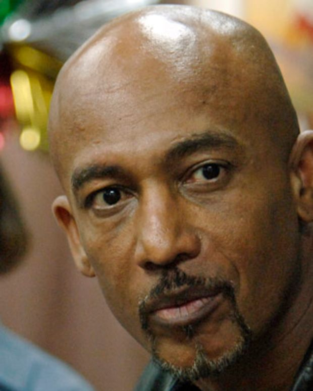 061205-N-8148A-074Persian Gulf (Dec. 5, 2006) - Montel Williams, a talk show host and former U.S. Navy lieutenant commander, spends time aboard guided-missile destroyer USS Howard (DDG 83) while traveling through the 5th Fleet area of operations to collect footage for a holiday special dedicated to U.S. service members. U.S. Navy photo by Mass Communication Specialist 2nd Class Kitt Amaritnant (RELEASED)